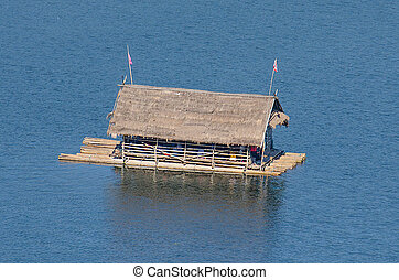 Floating house on river