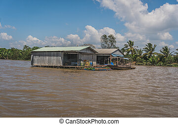 Floating house on the Mekong River