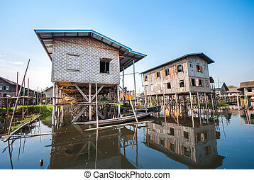 Floating houses in a village of Inle lake - INLE LAKE,...