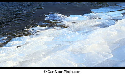Floating ice by the river , winter