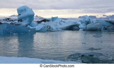 Floating icebergs in the glacial lake Jokulsarlon in the...