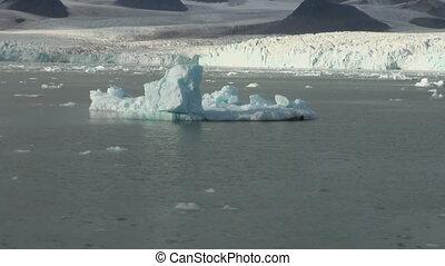 Floating icebergs on mirror surface of ocean sea.