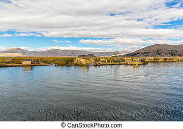 Floating Islands on Lake Titicaca Puno, Peru, South America, thatched home. Dense root that plants Khili interweave form natural layer about one to two meters thick that support islands