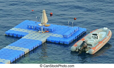 Floating jetty dock over coral reef at sea resort - Floating...