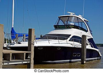 Floating Luxury - Luxury boat in a marina slip.