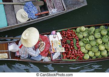 Floating market 1 - A fruit vendor in a boat at floating ...