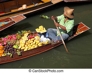 Floating Market - A trader at a floating market in Thailand