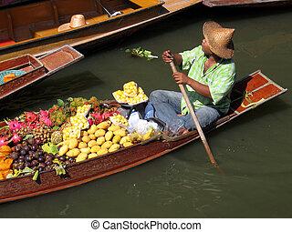 Floating Market - A trader at a floating market in Thailand