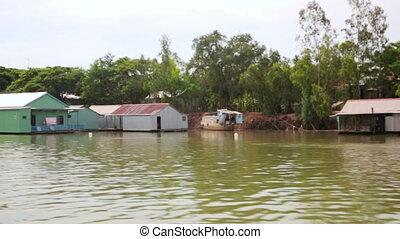 floating market slums near factory, mekong delta, vietnam