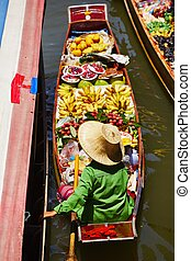 Floating market - Traditional floating market in Damnoen...