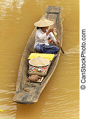 Floating market - Woman on a small rowboat at Myanmar ...