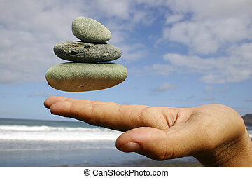Floating Pebbles - Pebbles floating at fingertips