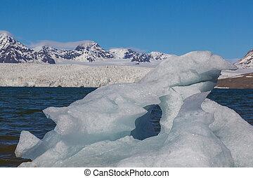 piece of ice in front of Esmarkbreen glacier in Svalbard, blue sky