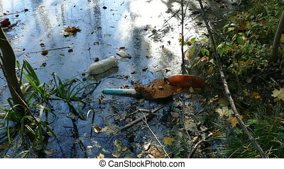 Floating Plastic bottles in a polluted pond water