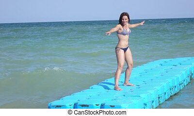 Floating platform at sea - WoMan on a plastic floating...