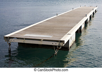 Floating pontoon anchored on calm sea