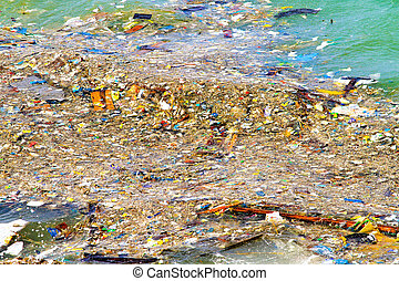 Floating rubbish - Disgusting pile of pollution floating in...