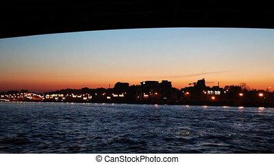 Floating under Liteyniy Bridge in night illuminated with lights St. Petersburg