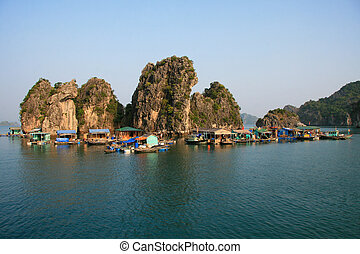 Floating village of Vietnamese boatpeople in Halong Bay.
