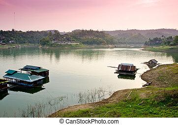 floating village in Kanchanaburi , Thailand