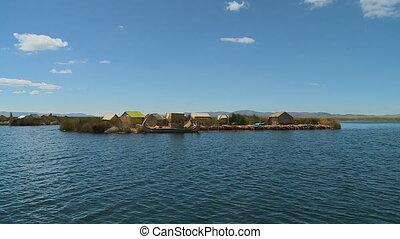 Floating Village On Lake Titicaca, Peru - Wide low angle...