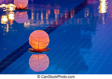 Floating water lantern in the pool