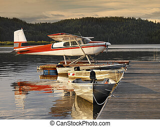 Floatplane moored at a jetty on Canim Lake in British Columbia, western Canada