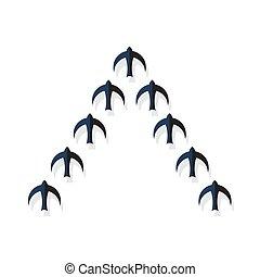 Flock of black birds flying in a strict order.
