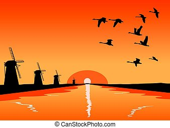 Flock of geese flying over river with mills at sunset