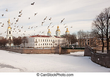 flock of pigeons over the Nikolsky Cathedral in St. Petersburg
