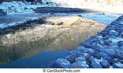 Floe floating on the river, illuminated by golden sun