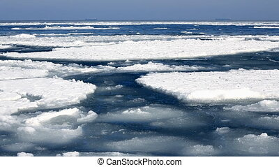 Floes drifting in winter sea time lapse