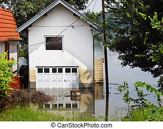 Flood - house in water - house surrounded by water in river...