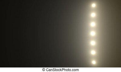 Flood lights disco background. Bright white spotlight bulbs is flashing