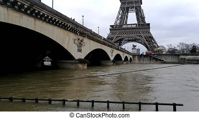 Flood of the Seine river in Paris with the Eiffel tower in...