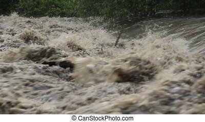 Flood river. Turbulent water. - Rough, turbulent water in...