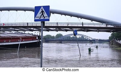Flood. Sidewalk covered with water from the river in Krakow,...