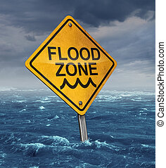 Flood warning concept with a yellow traffic sign flooded with water on a dangerous dark stormy cloud sky as a symbol of insurance risk and weather hazards as a natural disaster.