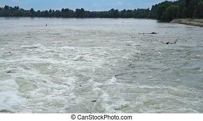 Flood water fast flowing down swollen mountain river