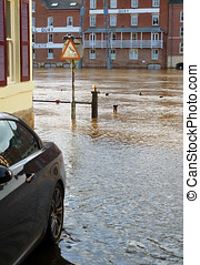 Flood waters - River Ouse flood waters reach parked car in...