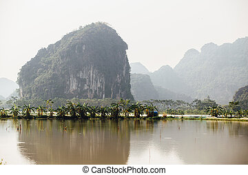 Flooded Asian country against the backdrop of the mountains in t