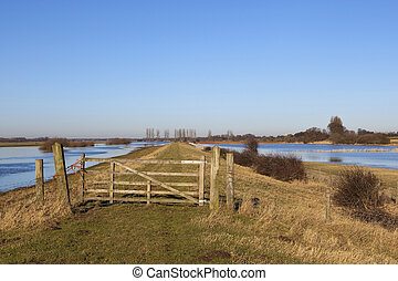 flooded landscape with gate