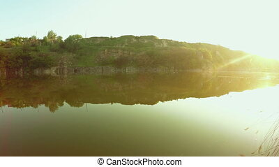 Panorama Quarry filled with water and overgrown with reeds
