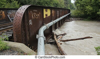 Flooded river & Bridge. Two shots. - Two shots of muddy...