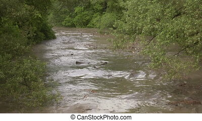 Flooded river. Two shots. - River after a flash flood,...