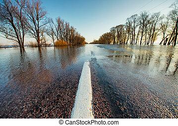Flooded rural road in spring