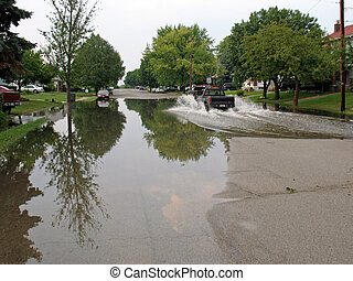flooded street - residential city street flooded after heavy...