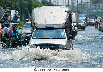 Flooded street with trucks and cars