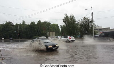 flooding?in town streets?after torrential rain
