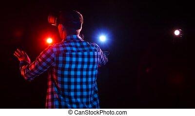 floodlights., réalité virtuelle, sombre, studio, gamer, homme, lunettes